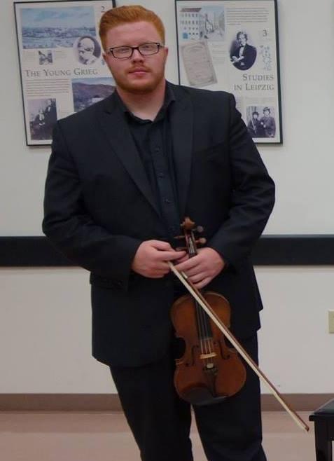 Antonio Foreman holding a violin