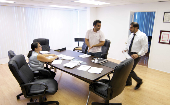 In his Miami office, Khurrum Wahid works with partner Carmen Vizcaino and assistant Imran Siddiqui.