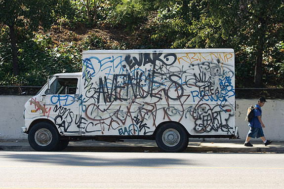 Avenues graffiti on parked van