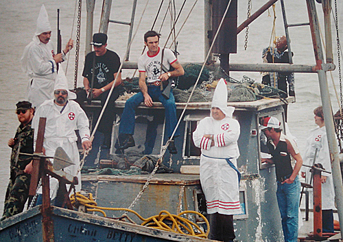 KKK members on boat in Galveston Bay