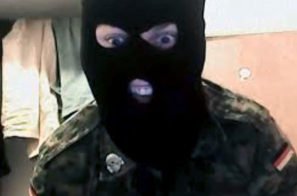 Zack Davies wearing balaclava in an online video.
