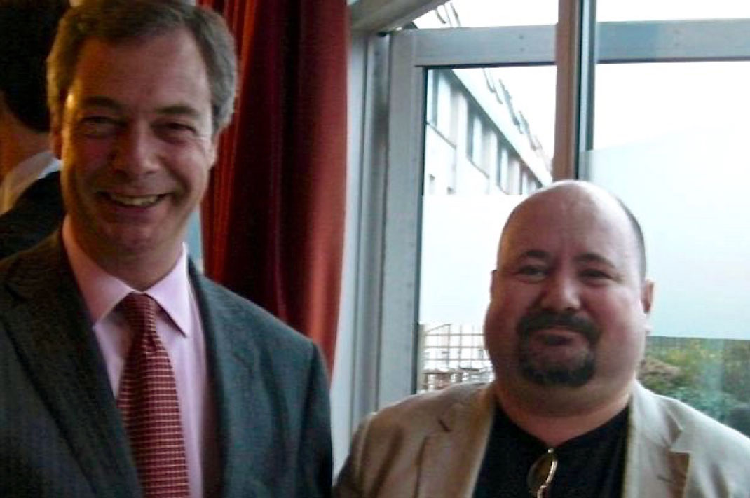 UKIP leader, Nigel Farage (L) with Andrew Lovie, neo-Nazi National Alliance member since 2000.