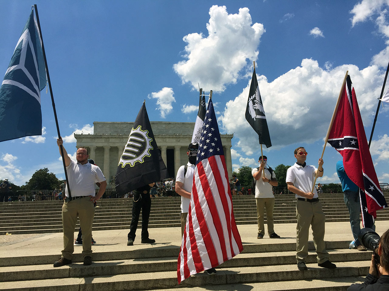 Flags for the Tradtionalist Workers Party, Identity Evropa, Vanguard America raised high alongside the Confederate battle flag outside the Lincoln Memorial.
