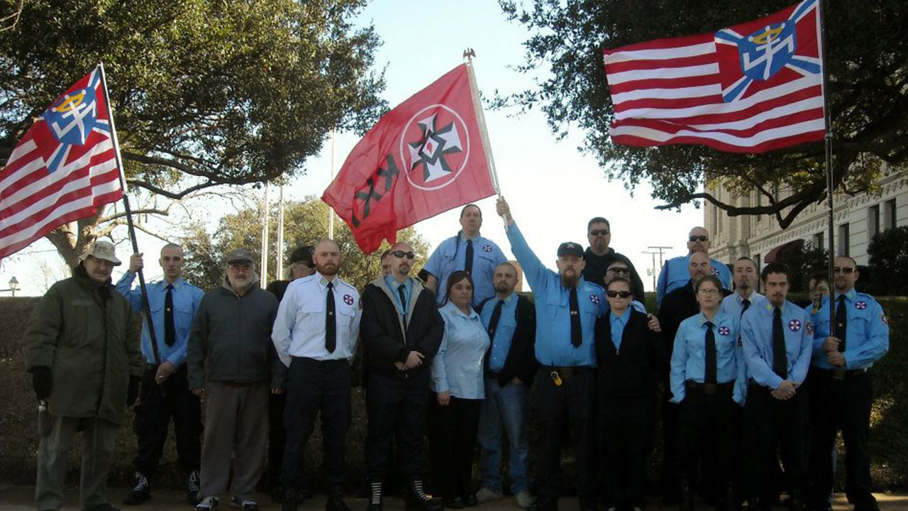 aryan nations The aryan nations was the collective homelands of the iranic peoples a nutjob christian identity, white supremacist, neo-nazi group in hayden lake, idahothe logo of aryan nations was a wolfsangel inside a sword with a crown on top in a blue shield and blue stripes with white outline on a red field, and also was part of a co-opted version of the american flag used by the group.