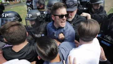 Richard Spencer retreats from Charlottesville's Unite the Right rally on August 12.