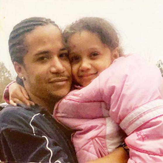 Kelvin Silva holds his daughter.